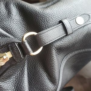 Coach Bags - COACH black leather tote. Adjustable sides.